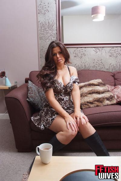 Plump housewife Leanne taking off and putting back on leather boots