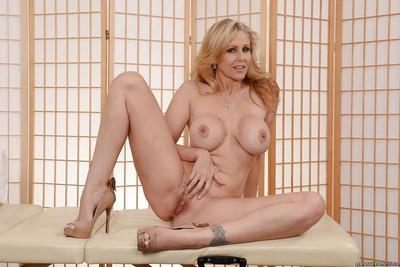 Blonde MILF Julia Ann stripping off denim jeans for nude photo spread