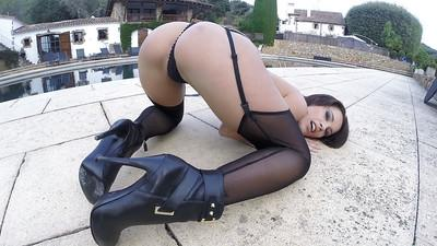 Tattooed MILF solo girl Nikita Bellucci showing off nice ass outdoors