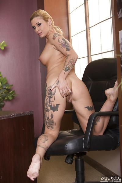 Inked pornstar Kleio Valentien shows off her perfect tits and bald twat