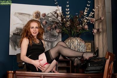 Redhead babe Tia Jones revealing MILF beaver in high heels and stockings
