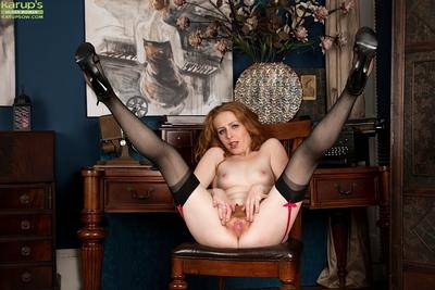 Redhead babe Tia Jones revealing MILF beaver in high heels and stockings