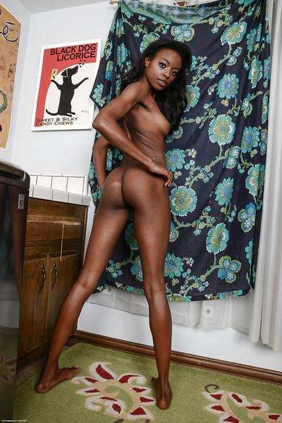 Ebony Tiffany Tailor is stretching her pretty-looking juicy booty