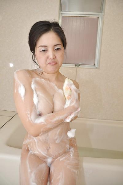 Milf brunette Miyoko Tanigawa is taking a hot shower on camera