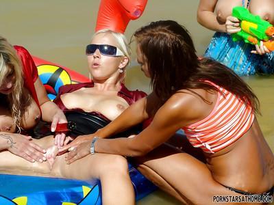 Lascivious pornstars with petite bodies are into CFNM action outdoor