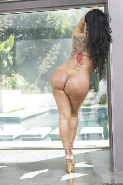Dark haired Latina girl with an amazing ass Kiara Mia posing
