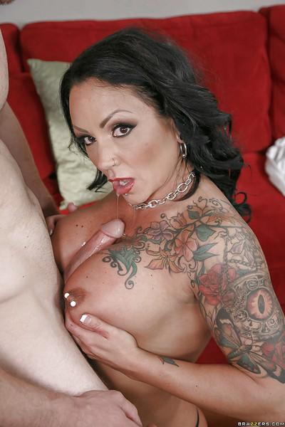 Pierced and tattooed MILF pornstar Ashton Blake sucking dick