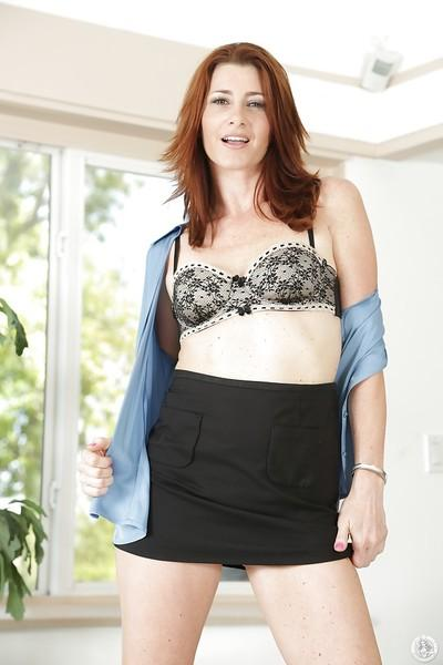Milf redhead Cici Rhodes is showing her tiny tits in a lingerie