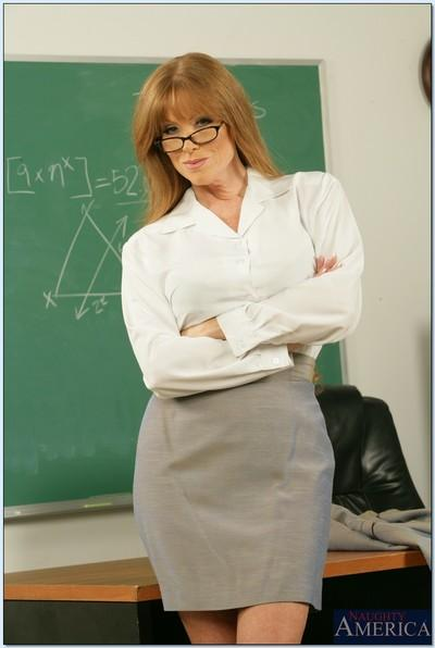 Redheaded teacher in glasses Darla Crane showing off bare MILF curves