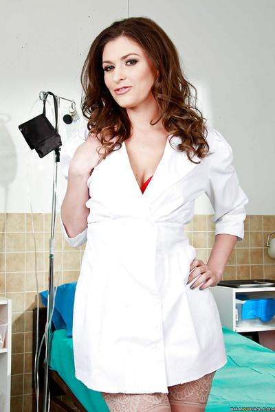 Stunning nurse Victoria Lawson taking off her uniform and lingerie