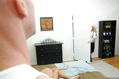 Booming blond MILF Candy Manson strips off paramedic uniform and fucks