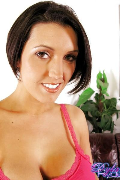 Smiley MILF reveals her big shapely melons and exposes them in close up