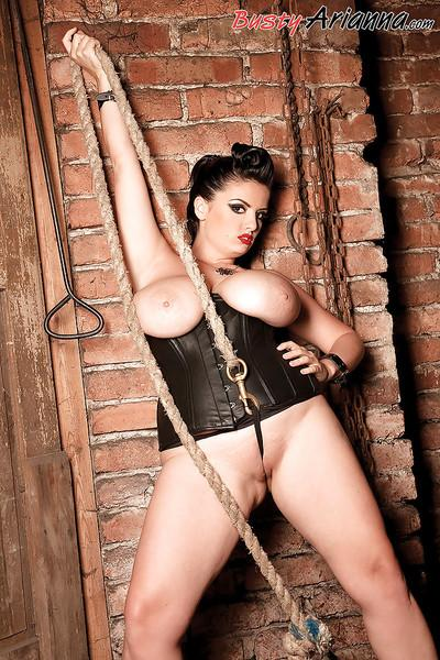 MILF plumper Arianna Sinn unveiling monster tits underneath leather outfit