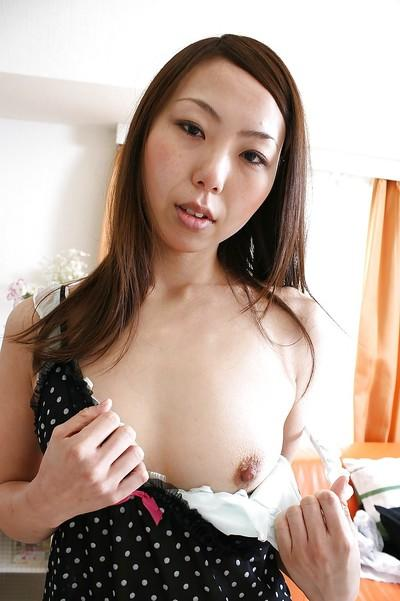 Asian MILF Akiko Iwashita stripping and exposing her unshaven gash