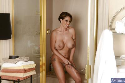 Ravishing MILF with big tits taking shower and rubbing her soapy curves