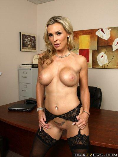 Sexy MILF babe Tanya Tate strips to her stockings in the office
