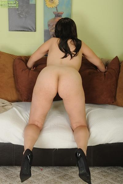 Dark haired milf Frederika is taking off her cougar panties