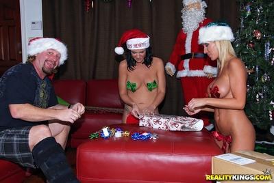 Naughty MILFs with big tits get a huge bulging cock for Christmas