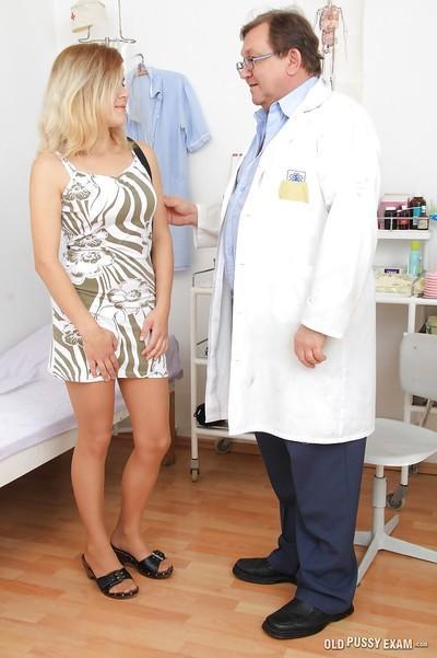 Stockings model Karen is demonstrating her milf pussy to her doctor