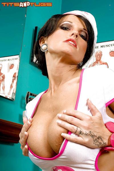 Brunette nurse Sarah Sunshine unleashing huge MILF hooters from uniform
