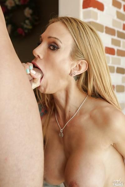 Milf blondie with sexy tattoos Sarah Jessie is enjoying a big cock