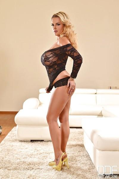 Curvy blonde MILF Katie Thorton squeezing her huge knockers