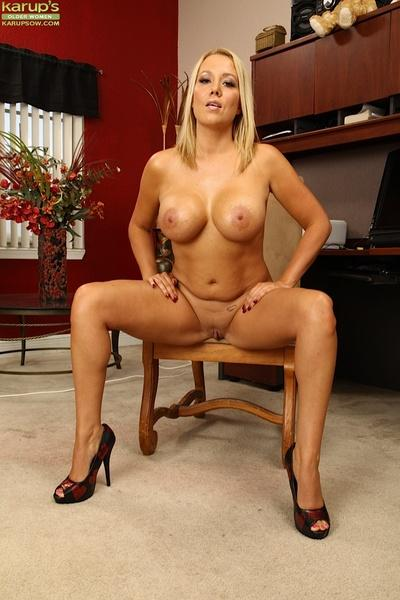 Clothed milf babe Tara Star reveals her fantastic big tit sin high heels