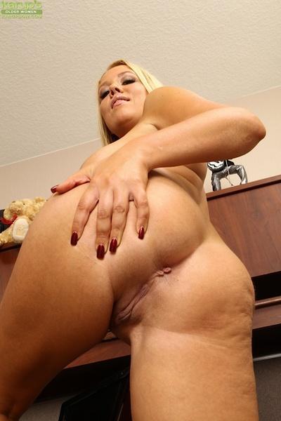 Clothed milf babe Tara Star reveals her fantastic big tit sin high heels
