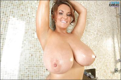 This magnificent brunette Sarah washing her titties in the shower