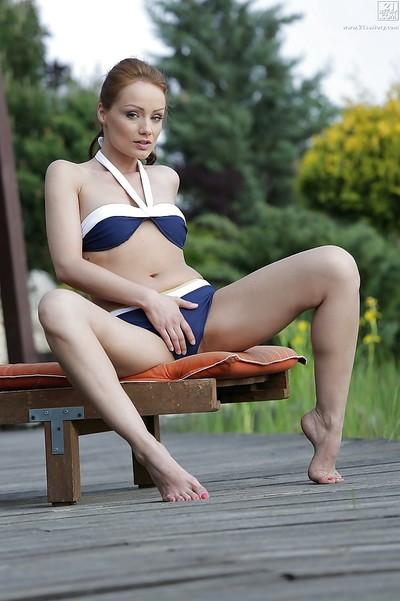 Leggy redhead MILF Sophie Lynx posing for candid bikini photos outdoors