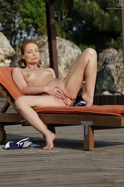 Leggy redhead MILF Sophie Lynx posing for candid bikini photos outdoors