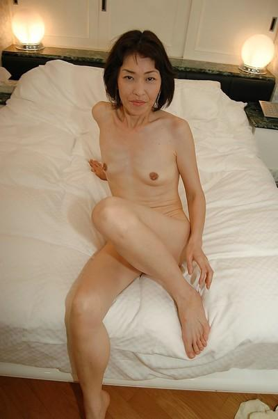 Horny asian MILF has some pussy toying fun after bathroom
