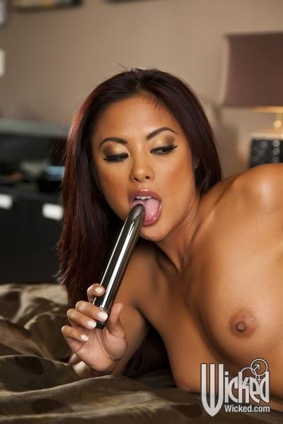 Asian MILF with big boobs Kaylani Lei teases her cunt with a dildo