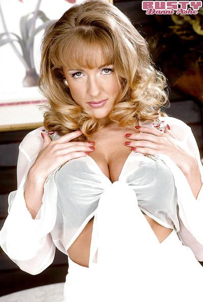 Busty blonde MILF model Danni Ashe posing in stockings and garters