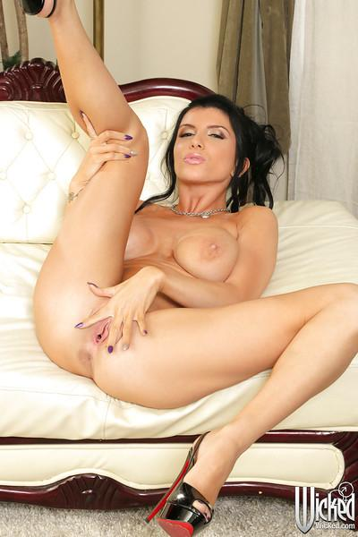 Fascinating milf pornstar Romi Rain is revealing her boobies