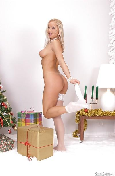 Blond babe Silvia Saint posing in white stockings and red high heels