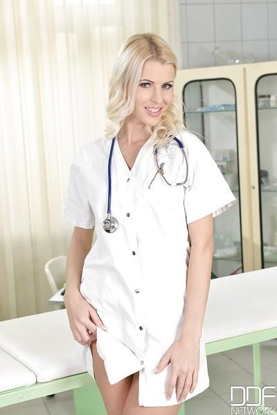 Blonde MILF Lynna Nilsson removing nurse outfit to expose puffy labia lips