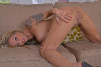 Blonde solo girl reveals big MILF tits and tattoos beneath sexy lingerie