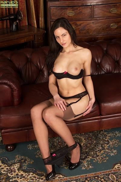 Slim MILF over 40 Michelle Khan posing fully clothed in garters and nylons