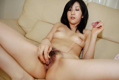 Horny asian MILF with hairy pubis has some pussy vibing fun