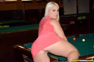 Busty blonde Bedeli Butland with big ass poses on the pool table