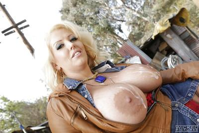 Busty older pornstar Alura Jackson sucking off a large cock outdoors