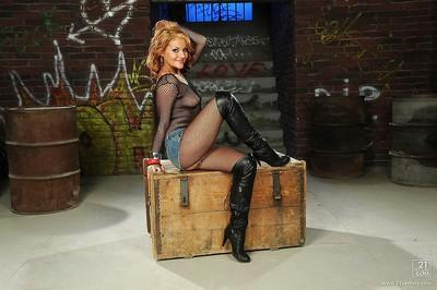 European milf Becky Stevens takes off her boots, skirt and pantyhose.