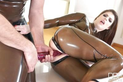 Kinky latex sluts Lucia Love and Latex Lucy use double dildo on wet cunts