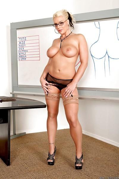 Luscious MILF in glasses Sadie Swede posing in nylon stockings