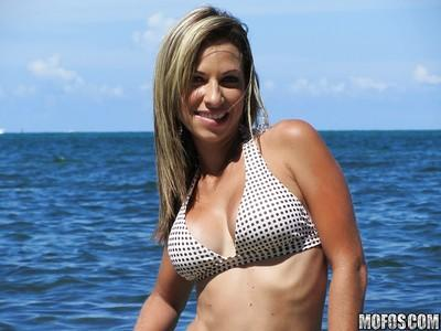 Latina babe Patty drops her bikini bra and flashes tits on the beach