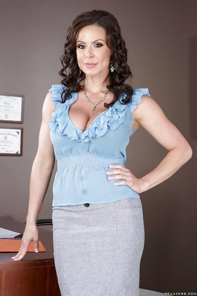 Brunette milf babe Kendra Lust teases her pussy while in stockings
