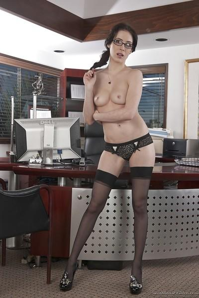Leggy chick with nice high heels is stroking her lovely vagina