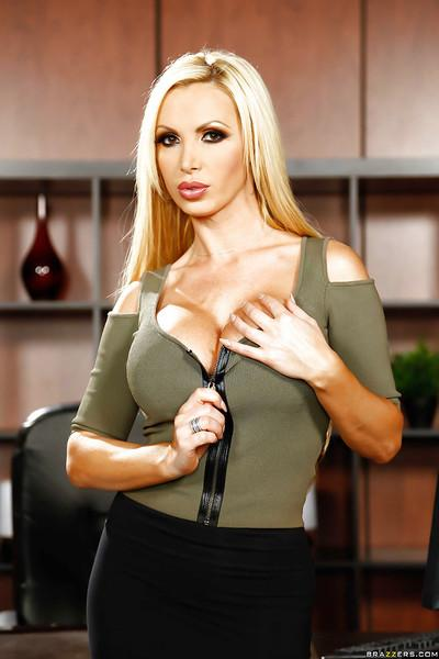 European blondie Nikki Benz is showing her fit body in grey lingerie