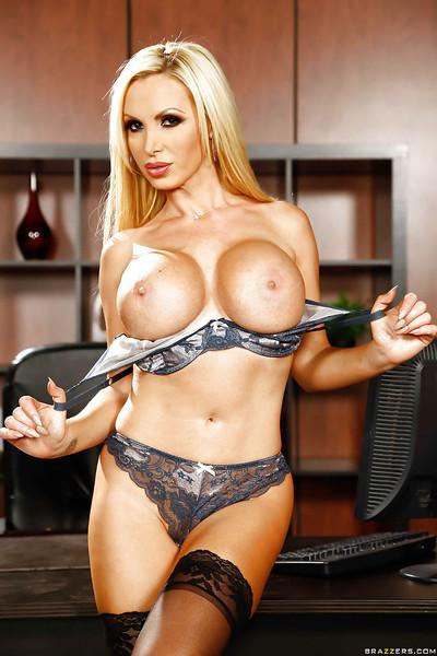 European blondie Nikki Benz is showing her fit body in grey lingerie